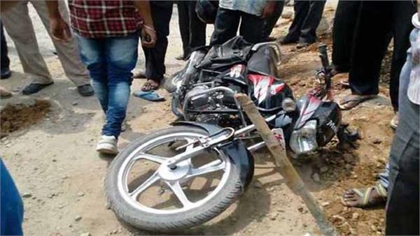 2 pieces of bike after tremendous collision with bus