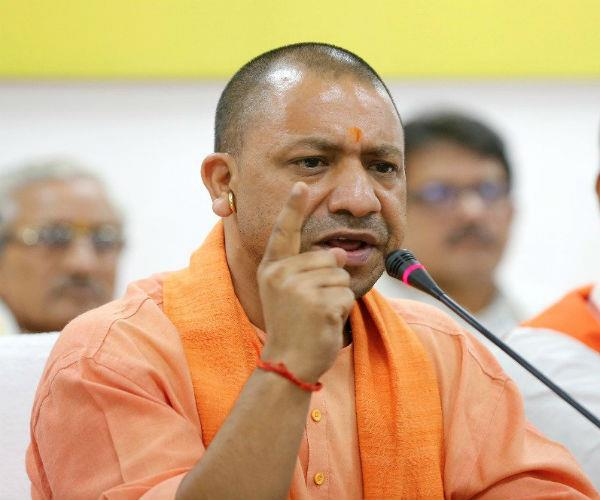 ram temple issue will be resolved by mutual consent  cm yogi