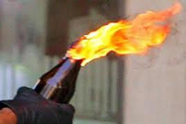 petrol bomb attack on policemen 1 citizen injured