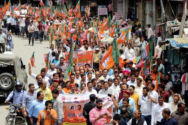 bjym sloganeering against the government  burnt effigy of cm