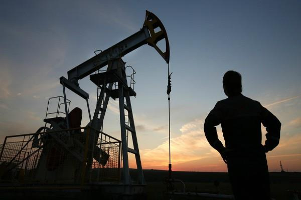 weakness in crude oil  gold moves flat