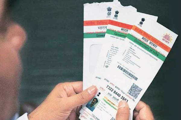 aadhar card essential for death certificate