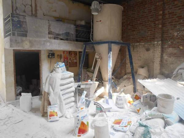 large number of fake paint and valves recovered from the factory