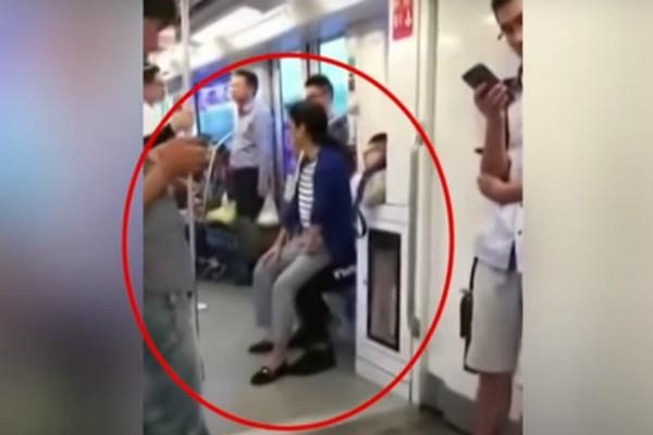 woman sit in man lap after he refuse to give her seat in metro