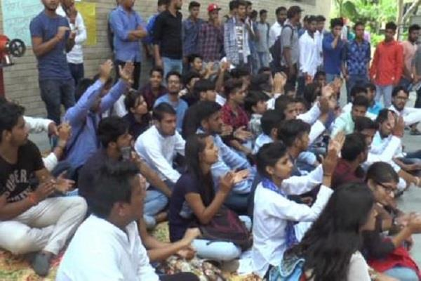 students sitting on dharna against the university gave these warnings