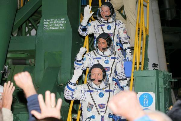 three astronauts reach iss for five month mission