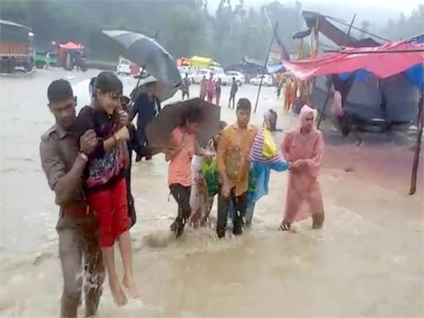 residents stranded in flood waters  police rescue them