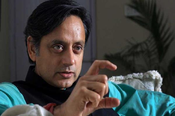 tharoor a word written on twitter about the book written on modi