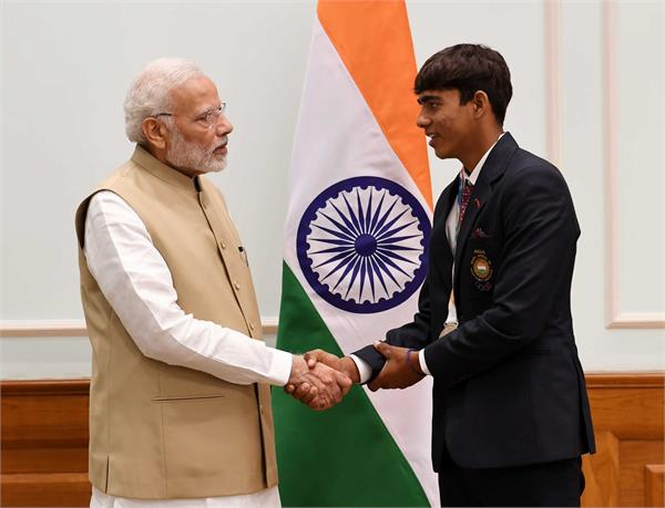 farmer s son organized history in archery pm modi congratulates