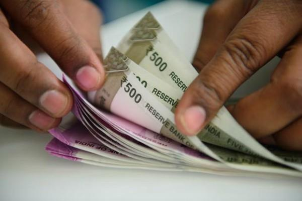 rupee declines to 74 47 against dollar