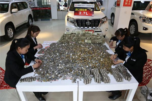 man bought a luxury bmw with one tonne worth of coins