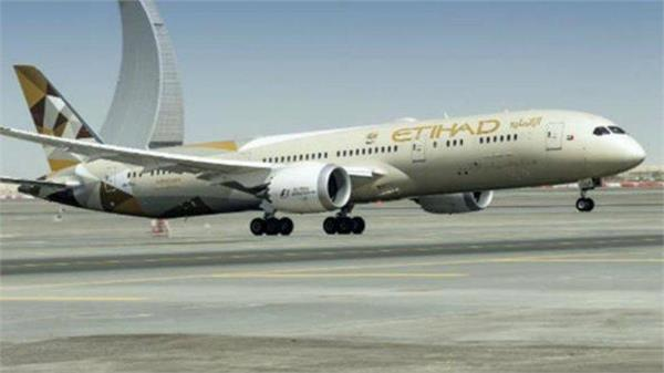 etihad flight diverted after woman gives birth onboard