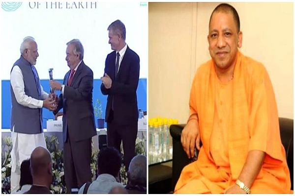 prime minister modi honored with champions of the earth award