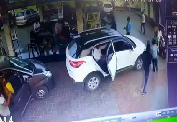beating on petrol pump