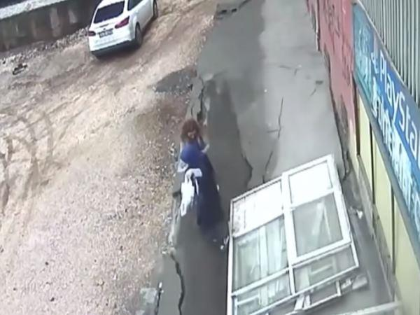 cctv footage 2 women swallowed by ground