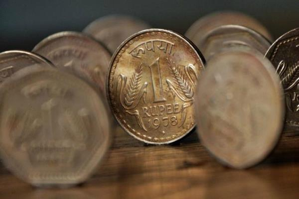 rupee rises 35 paise to open at 73 10