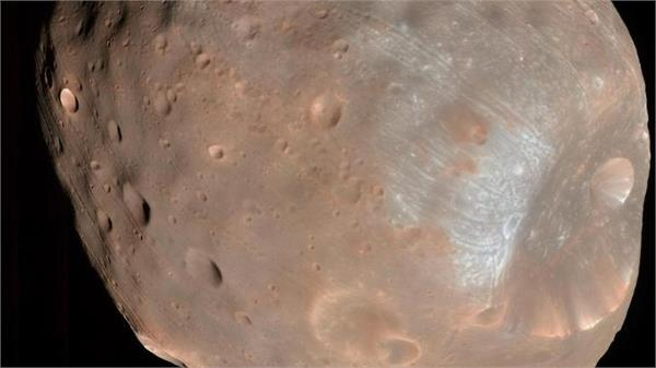 rolling stones left strange grooves on mars moon study