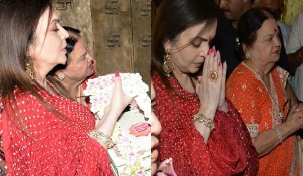 nita ambani visits ambaji temple for isha wedding invitation card