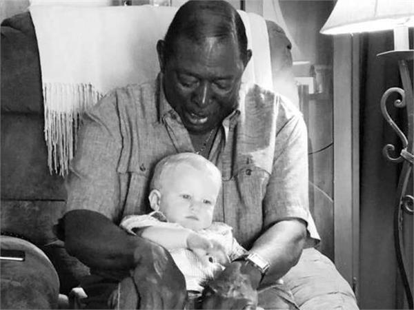 black man holds white baby pic goes viral
