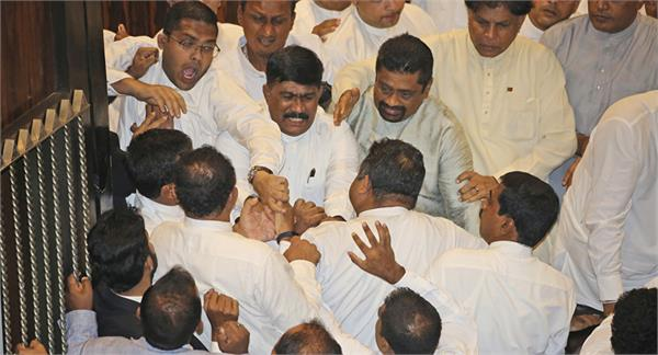 sri lanka mps hurl  chilli powder  and chairs in fresh chaos