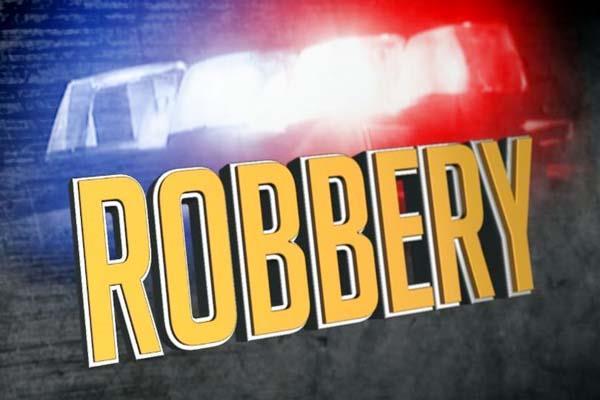 bike riders robbed the elderly shopkeeper