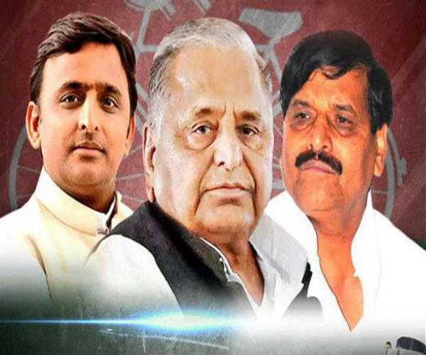 akhilesh signs for shivpal to come to the party shivpal also extends his hand