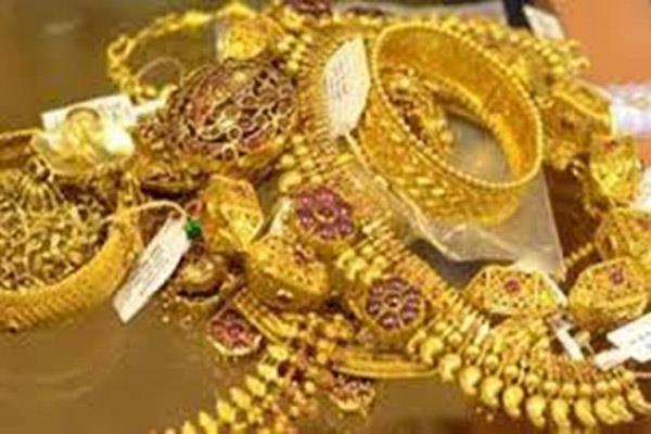 bride got married and thousands of silver and gold ornaments