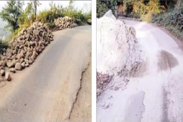 invitation to the streets with gravel and sand piled up road