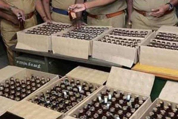seized 492 bottles of illegal liquor from a trolley near dhar