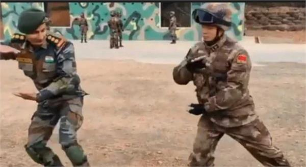 indian army officer learning tai chi from chinese soldier