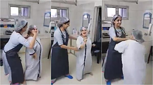 pregnant woman dancing with her doctor before delivery video viral