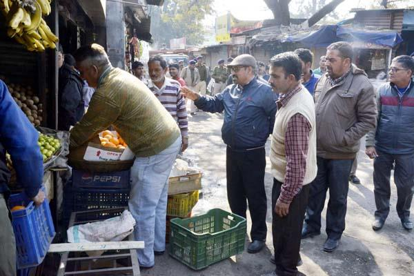 city council stick round on encroachment on road