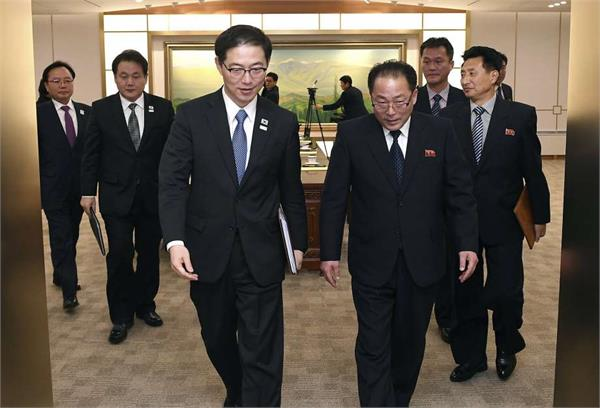 north and south korean teams to march as one at olympics