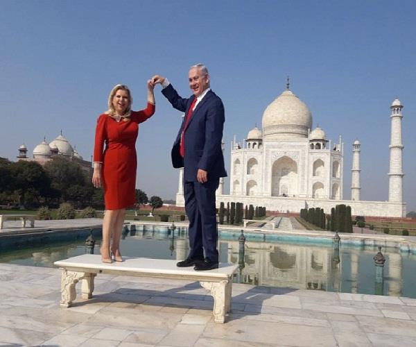 israeli prime minister accompanied by his wife