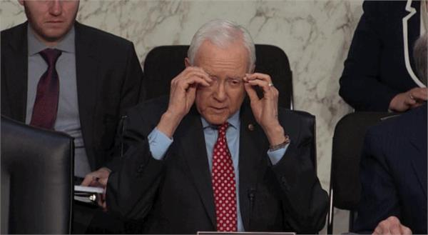orrin hatch takes off glasses that weren  t on his face