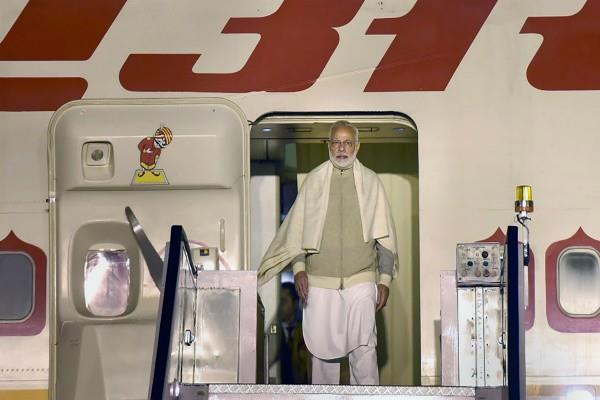 pm modi in work as soon as returning to davos