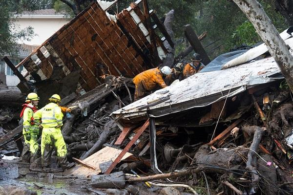 at leas 13 dead as heavy rains trigger flooding  mudflows