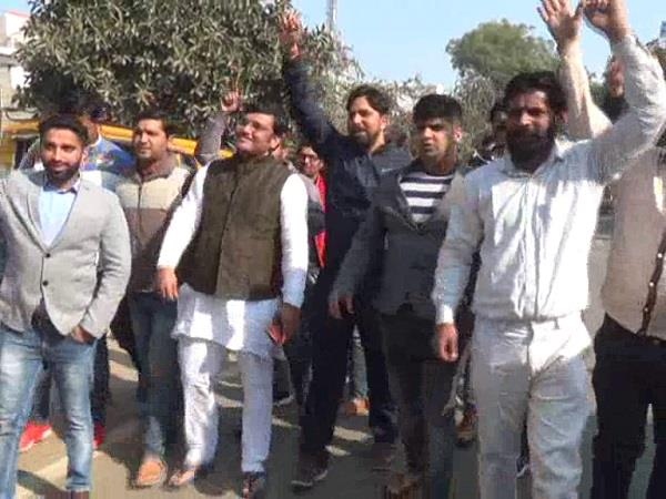 youth protesting against cm