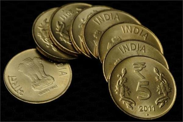 rupee up 7 paise to close at 63 66