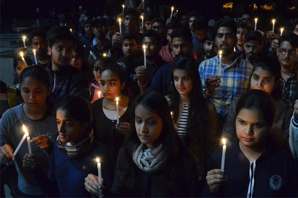 candle march released in protest against rising incidents of rape