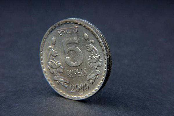 rupee gains 15 paise