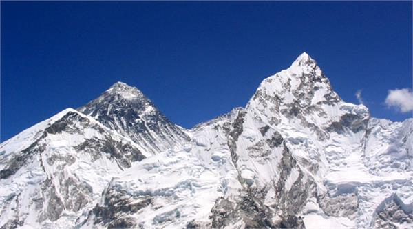 china denies changing height of mount everest