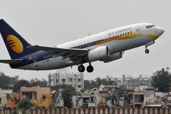 jet airways plane in air with 68 passengers