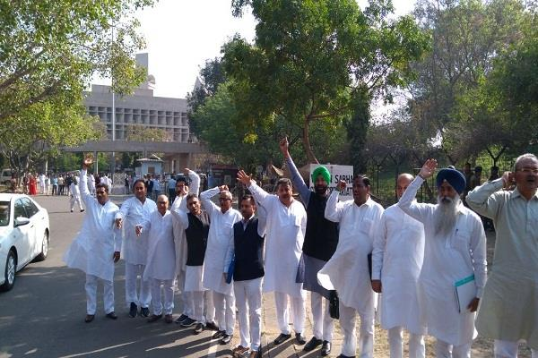 nld mlas protest slogan outside the assembly