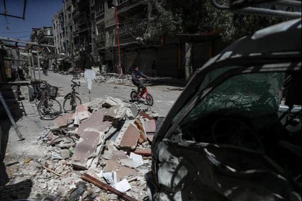 bombing in syrias douma area killing 27 people