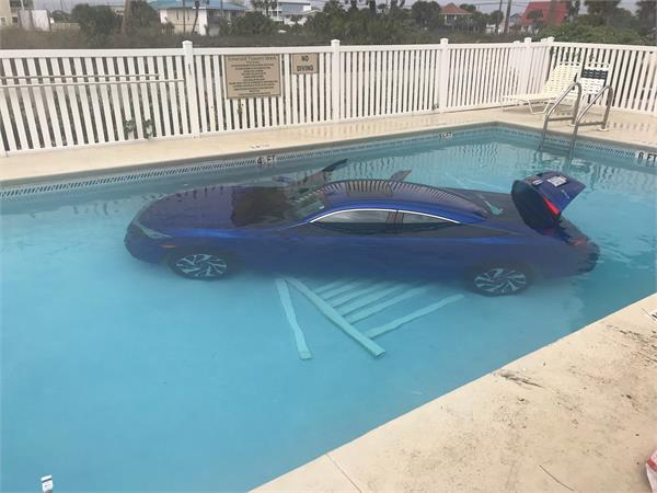 parked car floating in swimming pool photoes viral