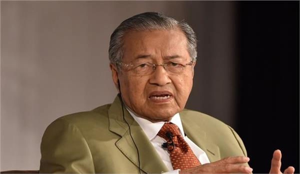 former malaysian pm to contest parliamentary elections on may