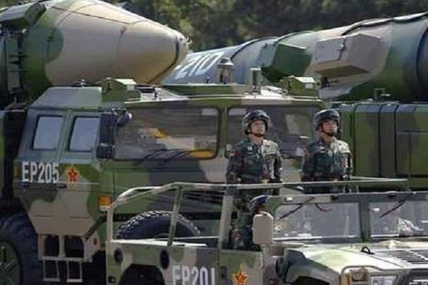 china activates medium long range missiles report
