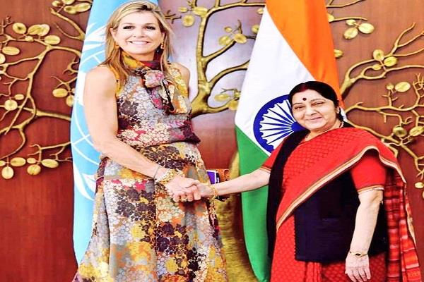 sushma meets the queen of the netherlands discusses financial inclusion