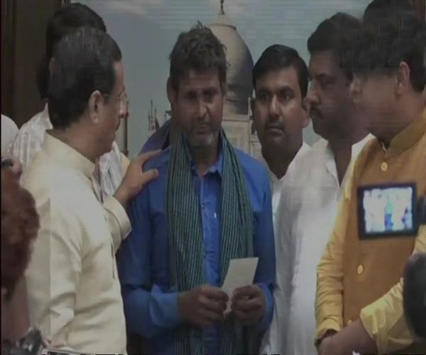 depth of storm victims in agra checks given by cm dinesh sharma